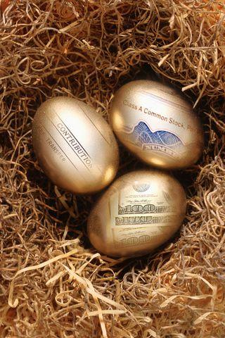 Nest egg - three gold eggs