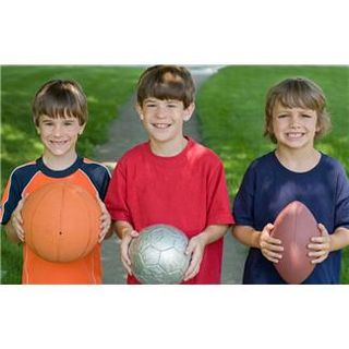 Three children with balls