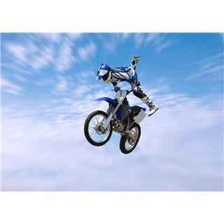 MotoCross biker jumping in the air