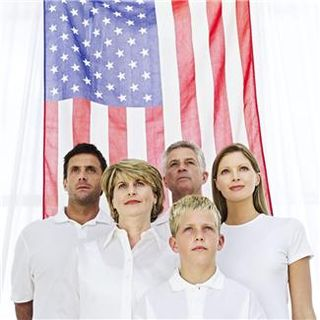 Family Standing in front of American Flag