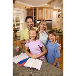 Family doing homework in kitchen