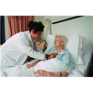 Female Nurse examining Elderly patient