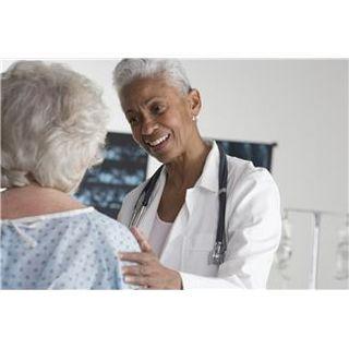 Female Doctor examining elderly patient